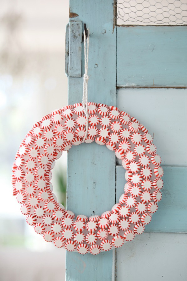 Darling peppermint candy Christmas wreath hanging on light blue farmhouse vintage door - Dreamy Whites. #christmasdecor #peppermintcandy #christmaswreath #dreamywhites