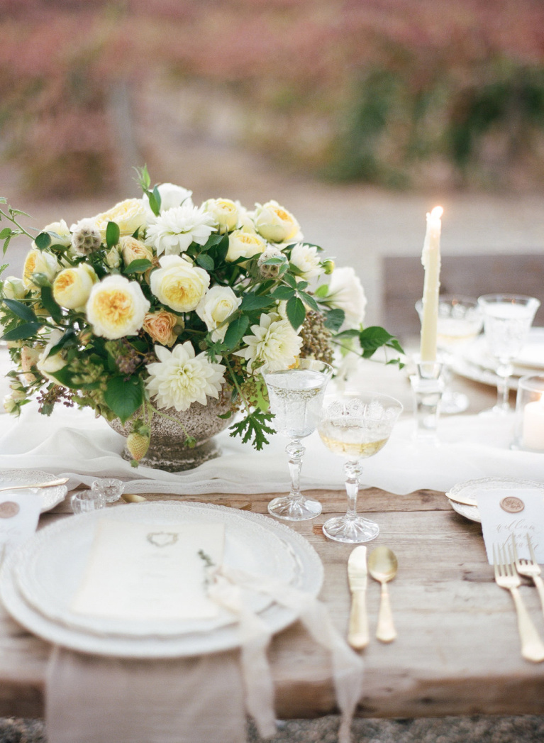 Lovely romantic wedding tablescape and place setting at a winery wedding - Flora and Spice.