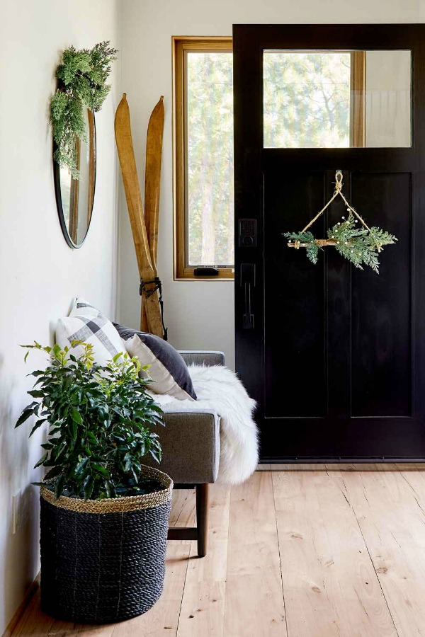 Christmas decorated entry with a natural modern farmhouse prairie vibe - styling by Emily Henderson for Target. #entry #interiordesign #holidaydecor #modernfarmhouse
