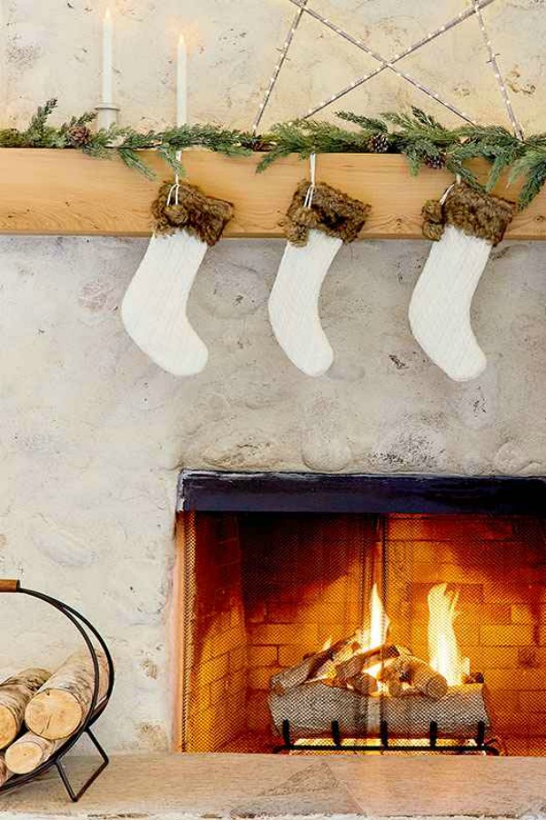 Cozy white Christmas decor and rustic fireplace - Emily Henderson for Target. #rusticdecor #holidaydecorating #fireplace