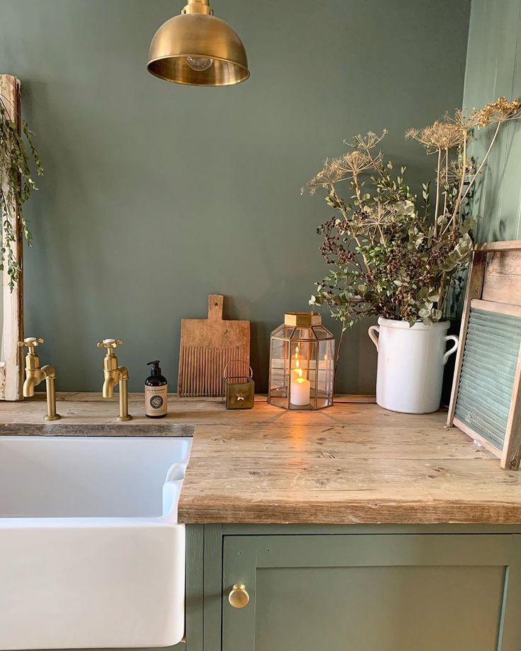 Farrow & Ball Smoke Green on walls and cabinets of a laundry room by Simply Scandi Katie. #farrowandball #smokegreen #paintcolors #deepgreen #greenpaint