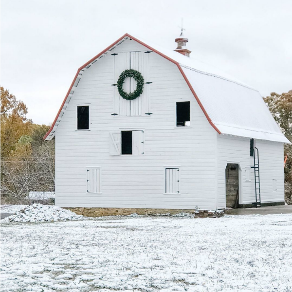Magnificent white barn with Christmas wreath at a country property in Knoxville, TN - Beside the Mulberry Tree. #christmasdecor #farmhousechristmas #whitebarn #whitechristmas