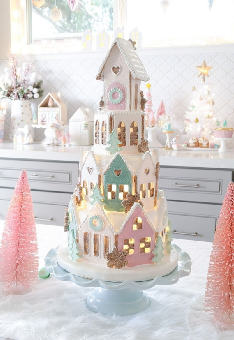Enchanting pastel Christmas gingerbread cookie village tower on a pedestal in a lovely kitchen @freshlyfuji.