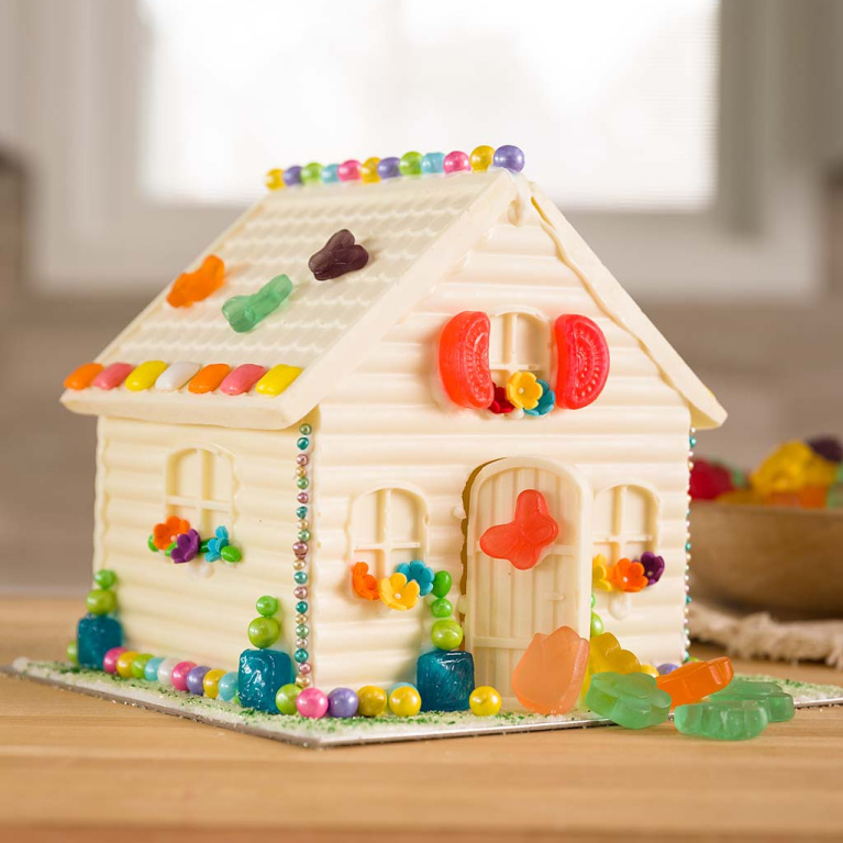 White chocolate candy house (gingerbread style house) for holiday crafting - Hearthsong at Walmart. #candyhouse #chocolatehouse #gingerbreadhouse #holidaybaking