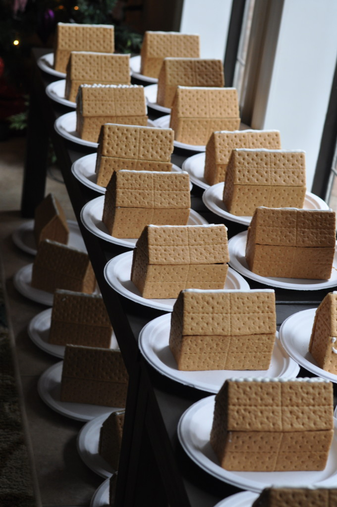 Gingerbread houses pre-assembled with hot glue for a decorating party - Eat This Up.