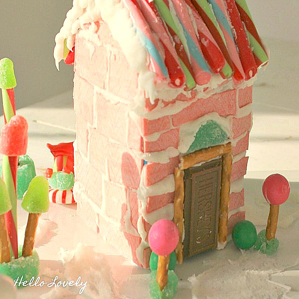 Wonky and quirky pink chewing gum gingerbread house - Hello Lovely Studio. #gingerbreadhouse #pinkchristmas #candyhouse #diy