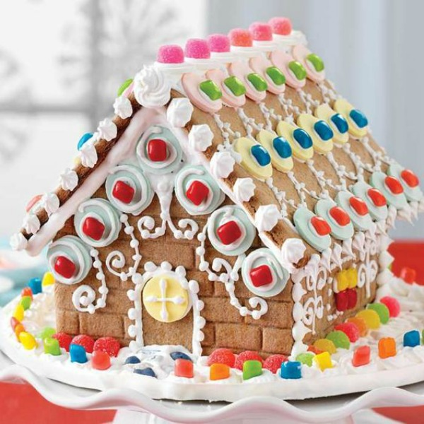 Colorful and fanciful gingerbread house decorated with circles - King Arthur Flour. #gingerbreadhouse #holidaybaking #christmasdiy