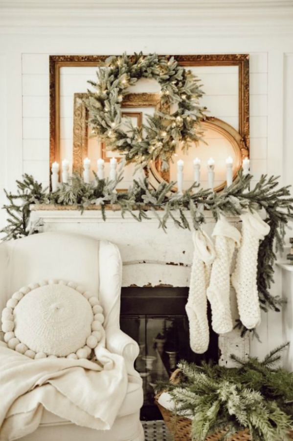 Fraser Firs, Balsam Trees, and Chunky Knit Stockings... are your holiday cozy feels going crazy yet? Liz Marie Blog's stunning farmhouse white Christmas decorated fireplace mantel.