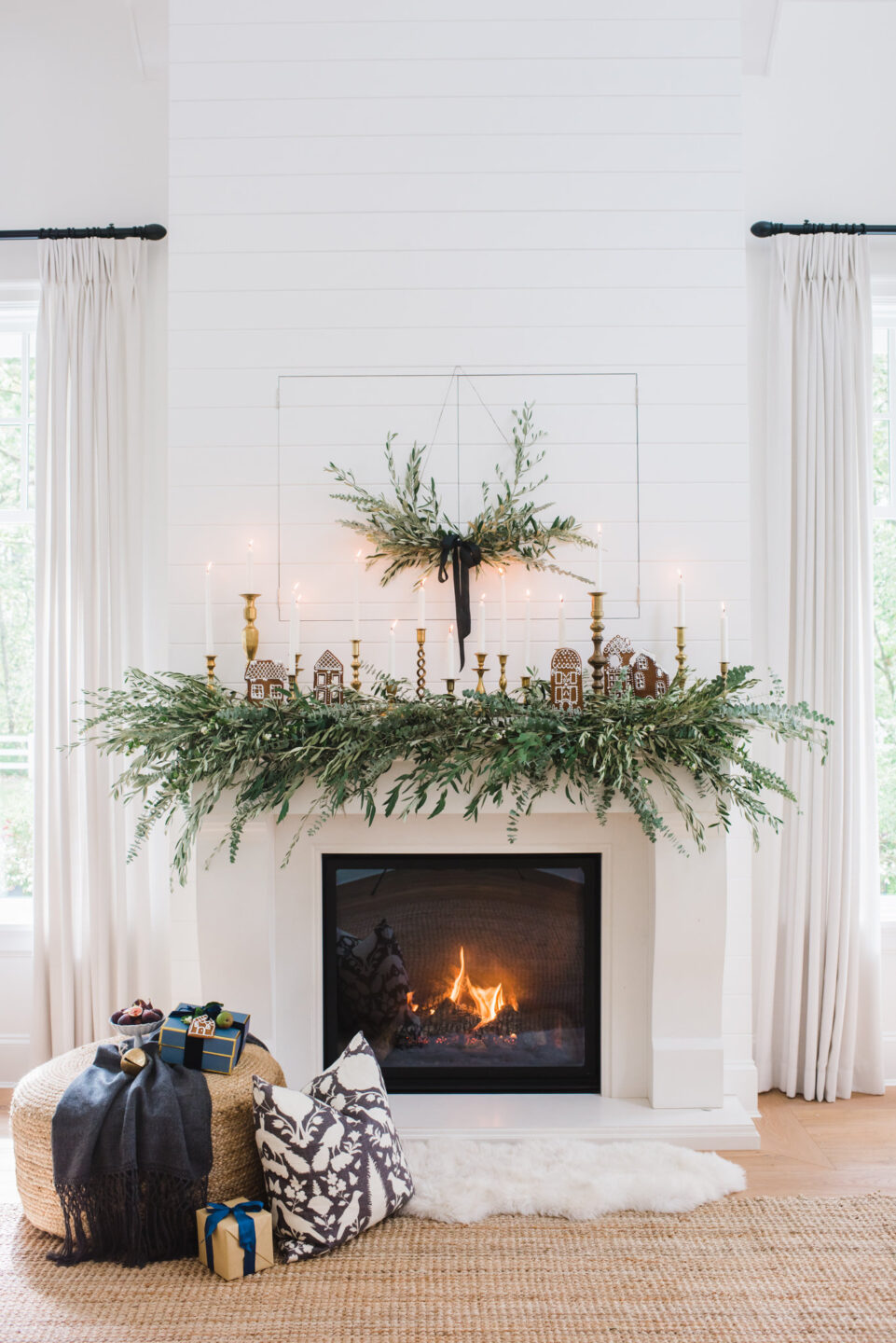 Beautiful holiday greenery on a white fireplace - Monika Hibbs. #holidaydecor #fireplace #garland