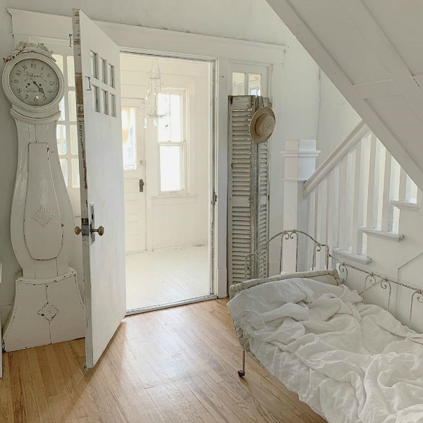 Charming Scandinavian farmhouse with white Swedish mora clock and French daybed - My Petite Maison.