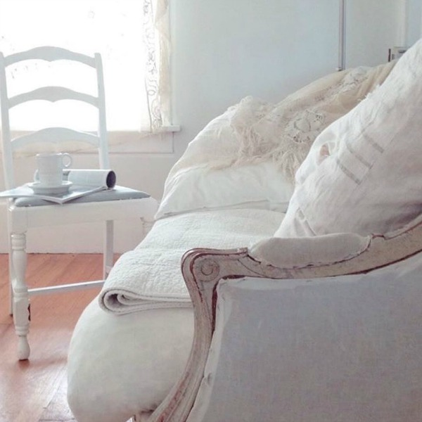 Vintage style and all white Scandinavian decor in a cottage by My Petite Maison.
