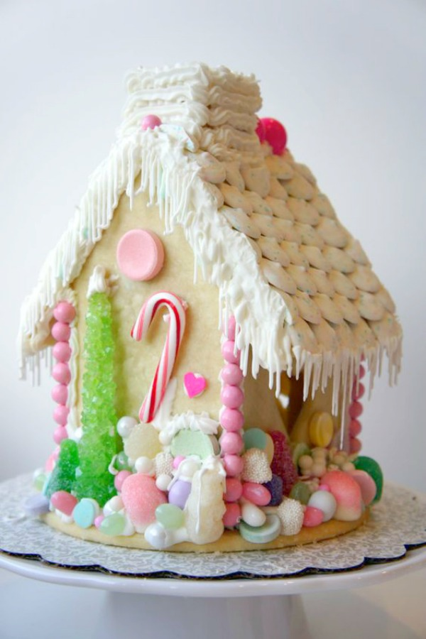 Whimsical and darling gingerbread house decorated with lots of pastels and pink. #gingerbreadhouse #christmasdecor #christmasdiy #holidaybaking