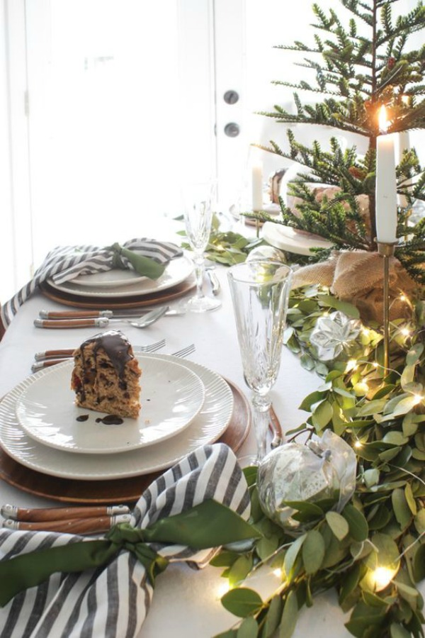 Country French farmhouse Christmas table with striped napkins - Shades of Blue Interiors. #christmastable #tablescapes #holidaydecor #frenchcountry