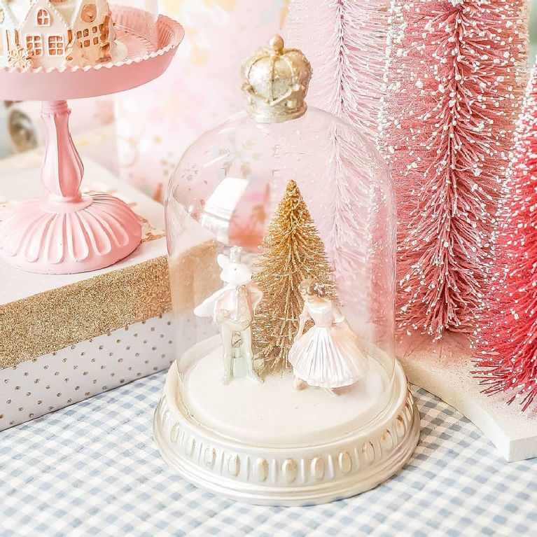 Magical pink Christmas vignette with snow globe and bottle brush trees @simpledaysmatter.