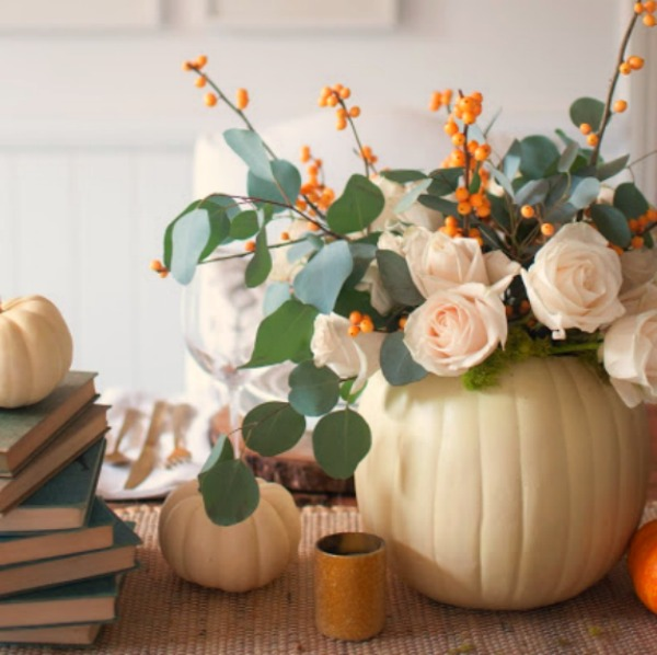 Gorgeous and simple fall centerpiece with white pumpkins, roses, bittersweet and eucalyptus - Gwen Moss. #falltable #pumpkincenterpiece #thanksgiving #tabledecor