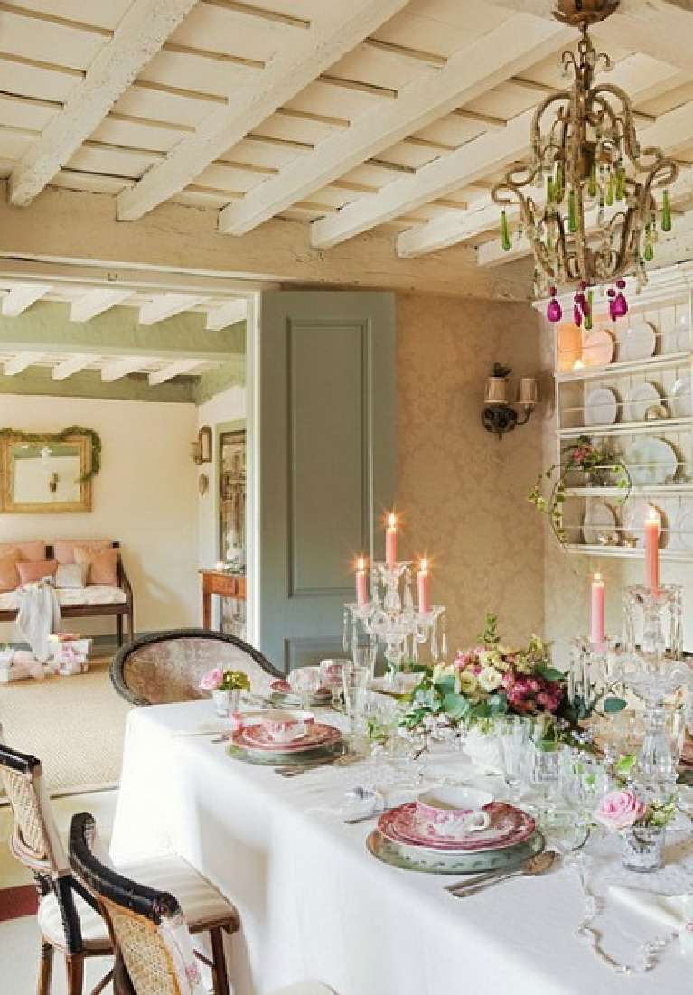 Beautiful French inspired dining room with pale pink and mint green accents and holiday decor with a romantic feel. El Mueble.