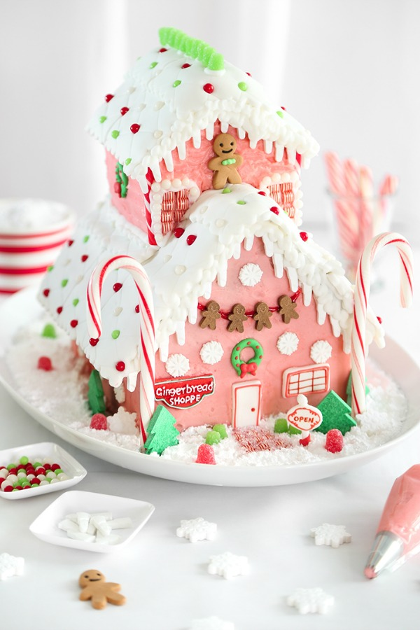 Magnificent pink gingerbread shop gingerbread house by Sprinkle Bakes! #gingerbreadhouse #candyhouse #pinkChristmas #holidaybaking