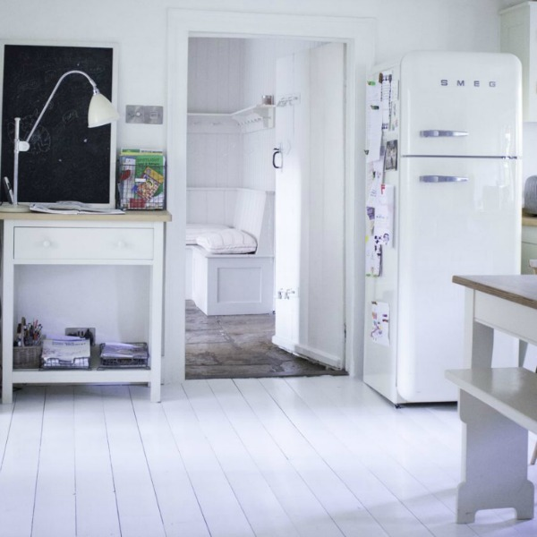 Kitchen with Smeg frig. Charming white Scandinavian style cottage interiors in a property called the Hatch (Beach Studios) near London. #scandinavianstyle #cottage #interiordesign #whitedecor