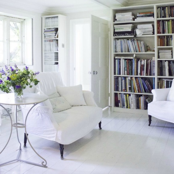 Bookshelves in living room. Charming white Scandinavian style cottage interiors in a property called the Hatch (Beach Studios) near London. #scandinavianstyle #cottage #interiordesign #whitedecor