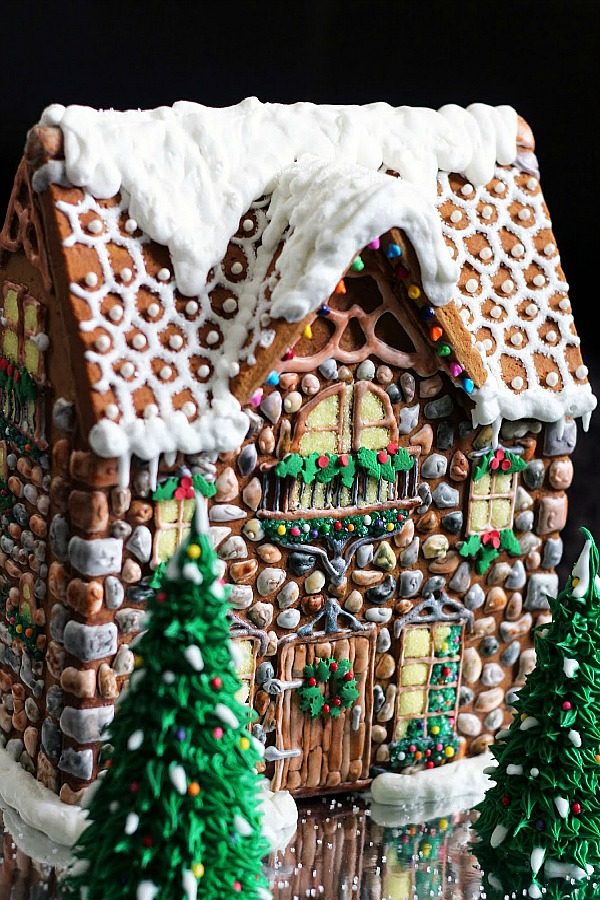 Fanciful and charming gingerbread house stone cottage - WorthPinning. #gingerbreadhouse #christmasdecor #diy