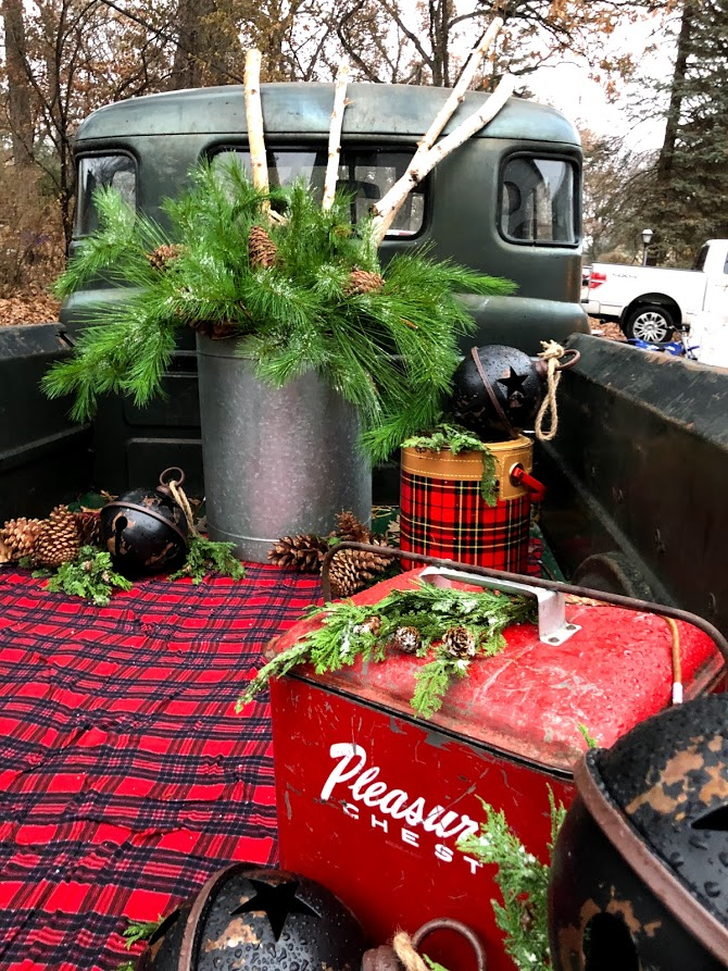 Christmas plaid farmhouse Christmas decor in a vintage truck at Urban Farmgirl - November 2019. Have Yourself a Cozy Little Christmas Decor, Faux Fur & Hygge