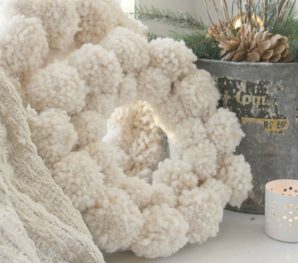 Pom pom wreath and rustic farmhouse Christmas decor - Hello Lovely Studio. #hellolovelystudio #christmastour #pompomwreath #farmhousechristmas
