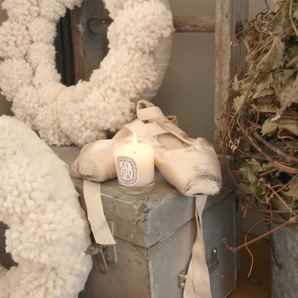 White Christmas decor vignette with pom pom wreaths and ballet slippers - Hello Lovely Studio. #christmasdecor #pompomwreath #christmaswreath #pinkchristmas