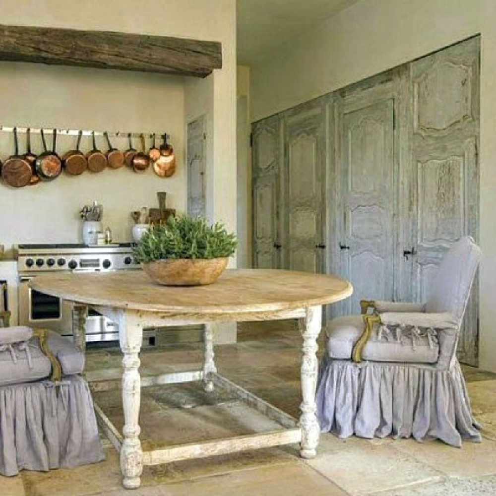 French country farmhouse kitchen with design by Pamela Pierce, architecture by Reagan Andre, and construction by MDD. Come score ideas for a Timeless and Tranquil European Country Inspired Look. #europeancountry #interiordesign #frenchcountry