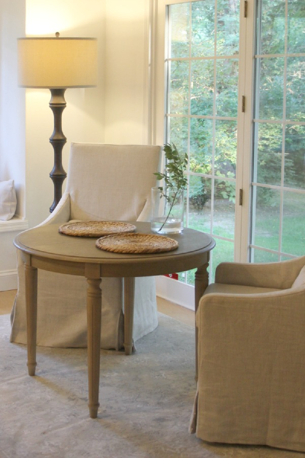 Window seat with linen pillows in European country inspired serene kitchen. Come score ideas for a Timeless and Tranquil European Country Inspired Look. #europeancountry #interiordesign #frenchcountry