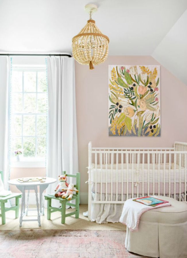 Pale pink nursery with white crib - walls painted Sherwin Williams Intimate White. #pinkpaintcolor #intimatewhite #interiordesign #pinknursery