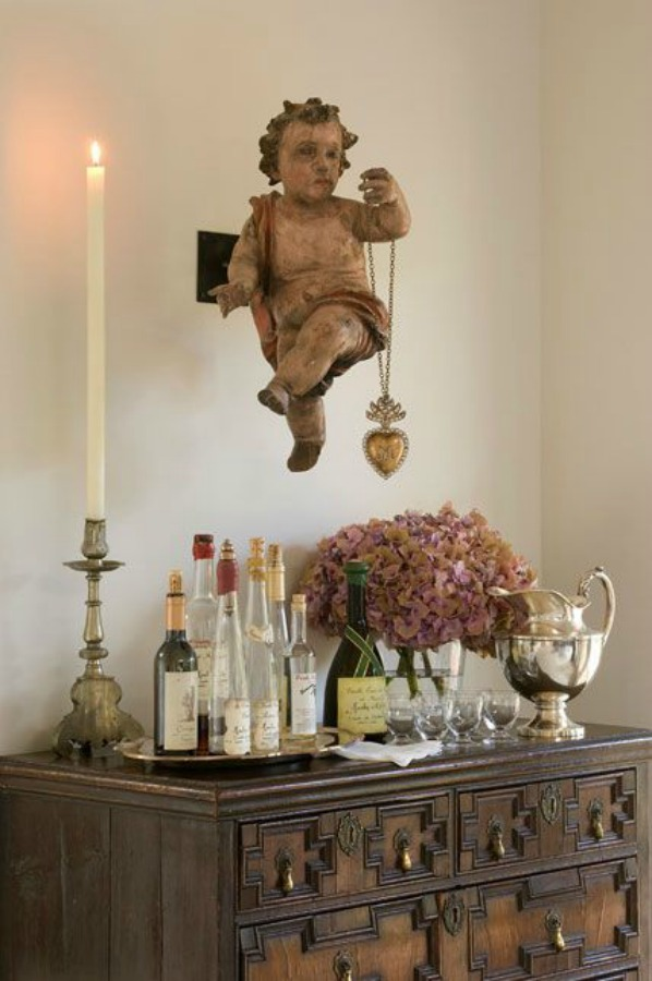 Exquisite cherub with ex voto heart in a lovely Santa Fe home - Photo by Peter Vitale for Milieu. #frenchcountry #europeancountry #oldworldstyle #interiordesign #cherub