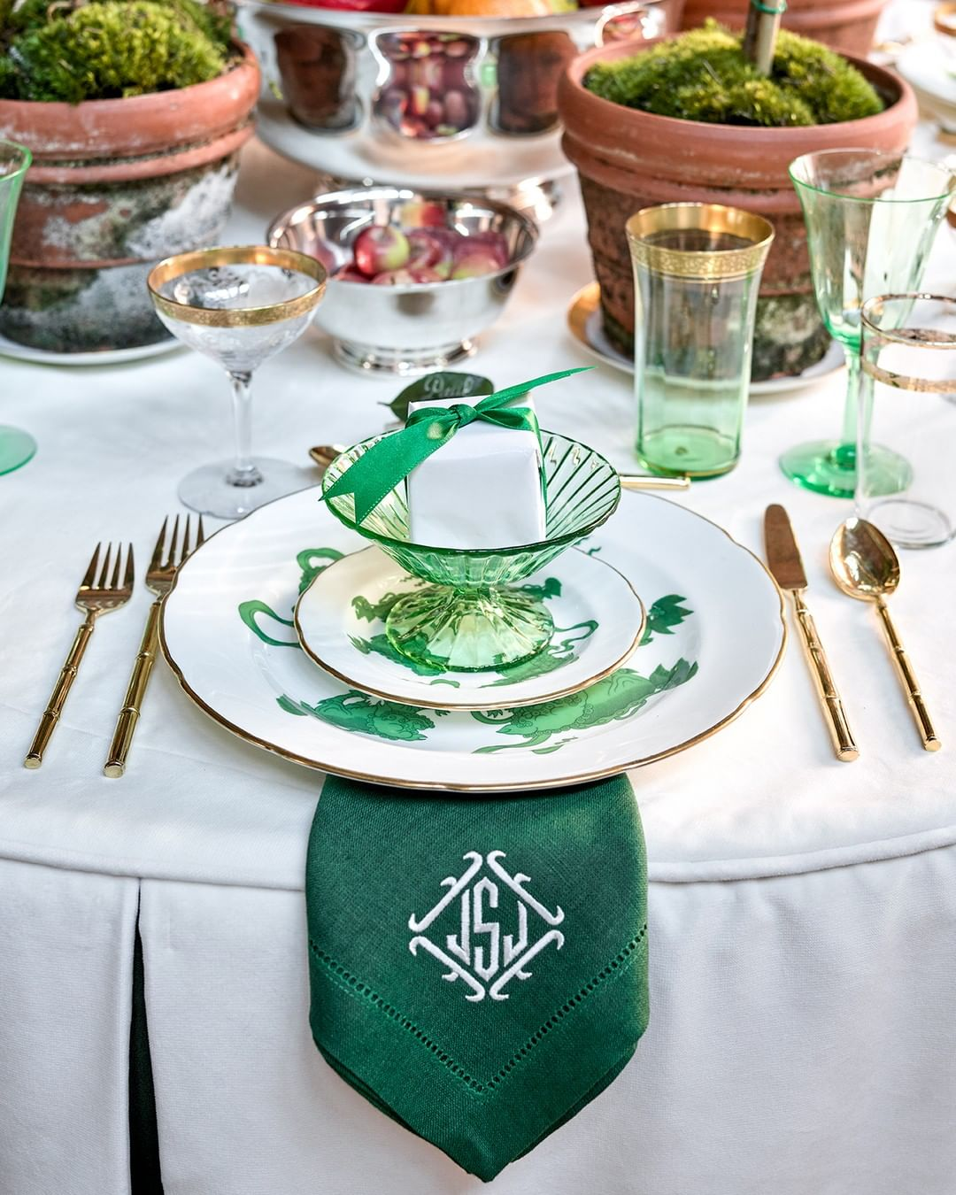 Gorgeous and elegant gree Christmas place setting and lovely tablescape by Jena Salmon for the Atlanta Home for the Holidays Showhouse 2019.