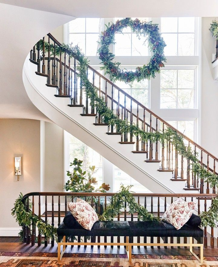 Magnificent architecture and staircase in the Atlanta Home for the Holidays Showhouse with architecture by Harrison Design and Design by Chris Holt. Photo by DHCPhoto