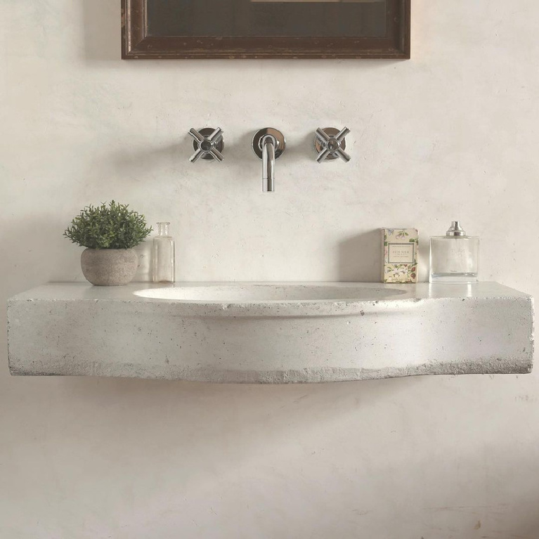 Serene and beautiful white limestone sink with modern wall mount taps in an ethereal bath - @atmosphyrellc