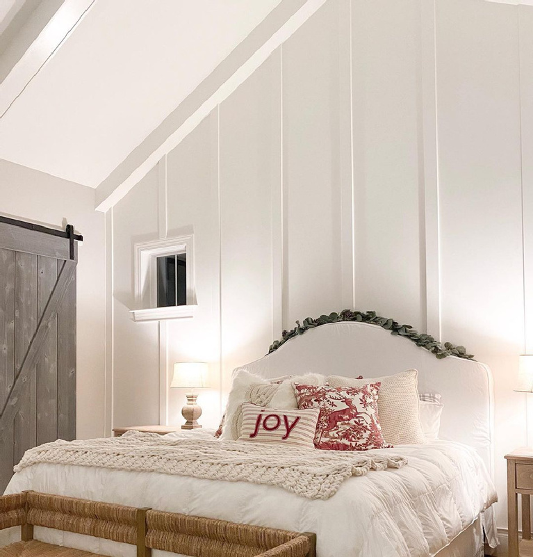 Benjamin Moore White Dove painted board and batten wall in charming bedroom by whitehomeonthehill. #whitedove #benjaminmoore #whitedovepaint #whitepaintcolors #bedrooms