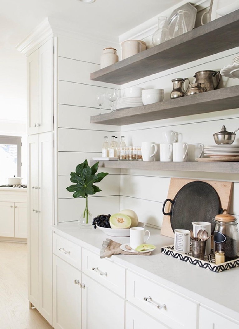 Gorgeous floating shelves and white shiplap painted White Dove in a designer's Atlanta kitchen - Sherry Hart. #floatingshelves #whitekitchen #whitedovepaint #benjaminmoorewhitedove #shiplap