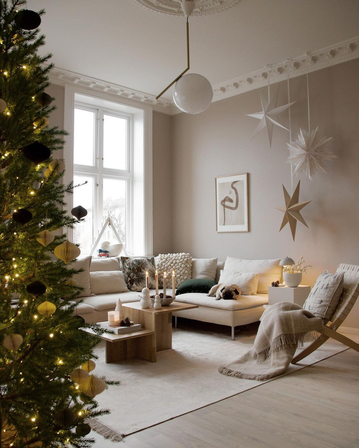 Beautiful Scandinavian Christmas decorated living room with dog lounging on Bemz covered sofa - Niblu Home. #bemz #nibluhome