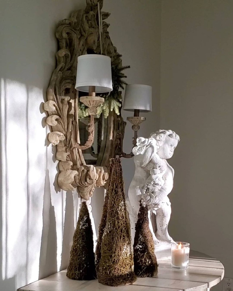 French country Christmas decor vignette with moss trees, antique sconce and cherub - TheFrenchNestCoInteriorDesign.