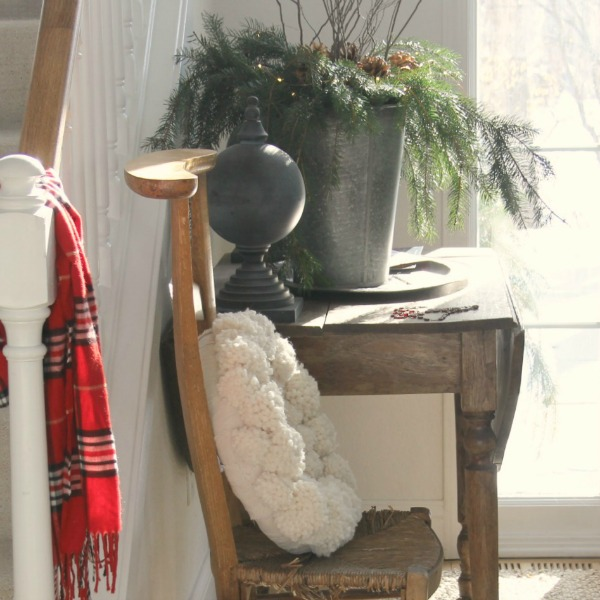 Holiday decor in my rustic European country entry - Hello Lovely Studio. #hellolovelystudio #holidaydecor