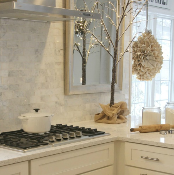 White Christmas decor in my classic white kitchen - Hello Lovely Studio. #hellolovelystudio #christmasdecor #whitechristmasdecor