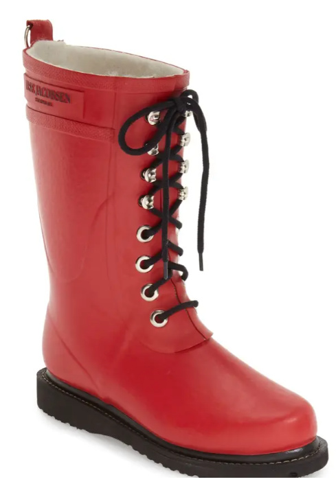 Red lace up rubber rain boots by Ilse Jacobsen.