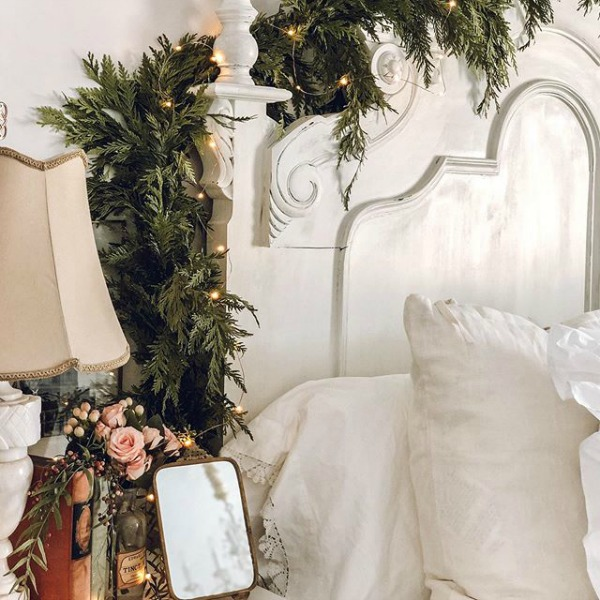 White Christmas decorated French country bedroom by Le Cultivateur.  23 Charming Christmas Decorating Ideas to Save for 2020. #christmasdecor #frenchchristmas #christmasbedroom #holidaydecor