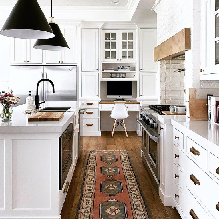 Snowbound (Sherwin-Williams) white paint in a beautiful classic kitchen with black dome pendants over island - @hawkes.landing #sherwinwilliamssnowbound #snowboundpaint