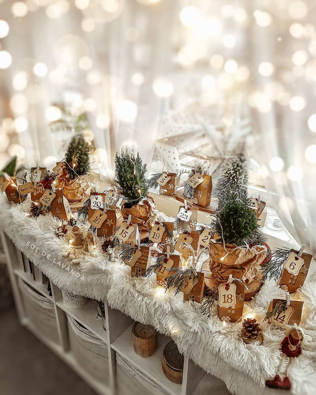 Magical Scandinavian Christmas vignette with advent calendar and fairy lights - @sol.de.lavanda