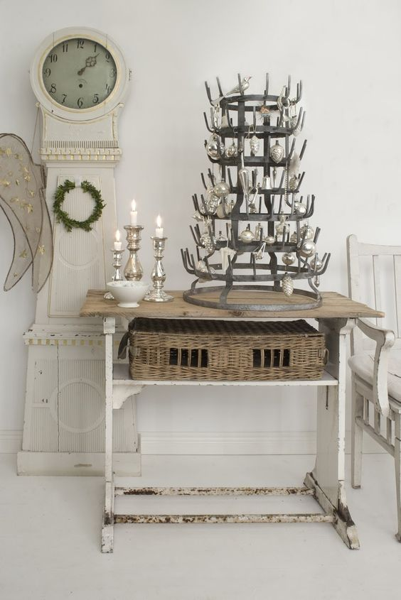 Swedish Christmas and Scandinavian holiday decor idea with vintage bottle rack as Christmas tree with sweet ornaments. The mora clock in foreground is a gorgeous touch! #swedishchristmas #bottlerack #christmasdecor
