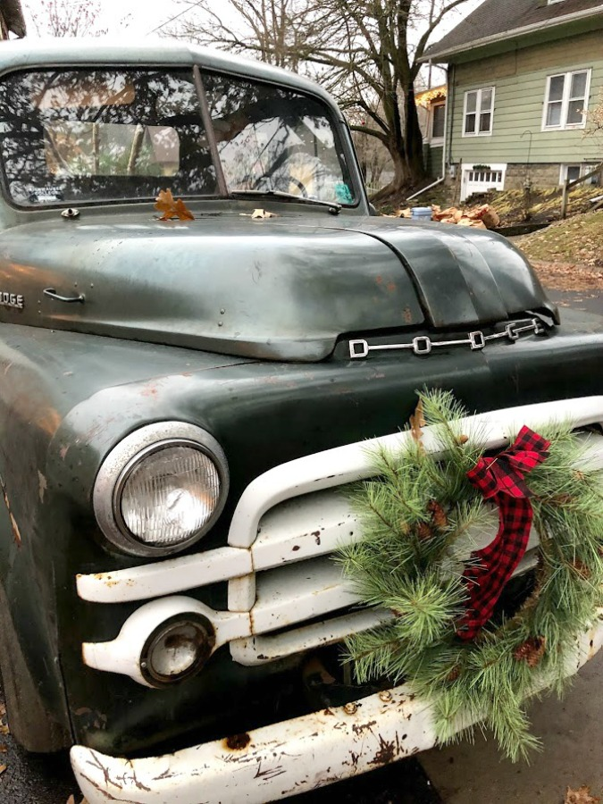 Vintage pickup truck decorated with wreath for Christmas at Urban Farmgirl - Hello Lovely Studio.