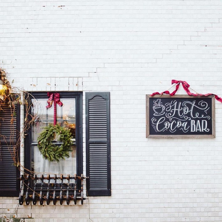 White brick farmhouse exterior with black shutters - Urban Farmgirl's holiday open house 2019.