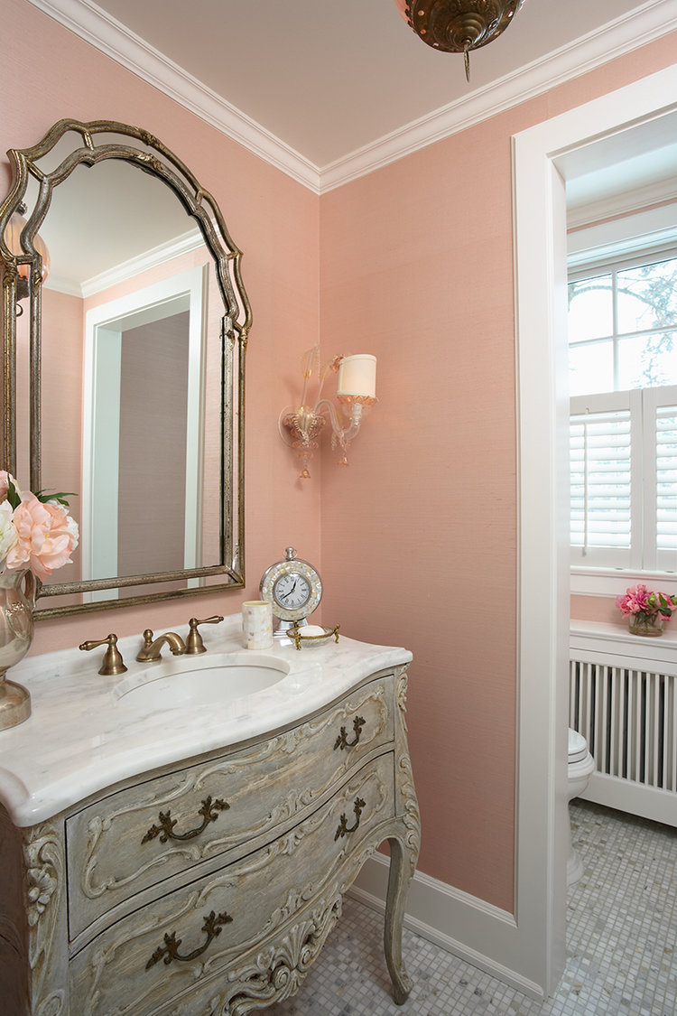 Pretty and elegant bath with warm peachy pink walls - RLH Studios.
