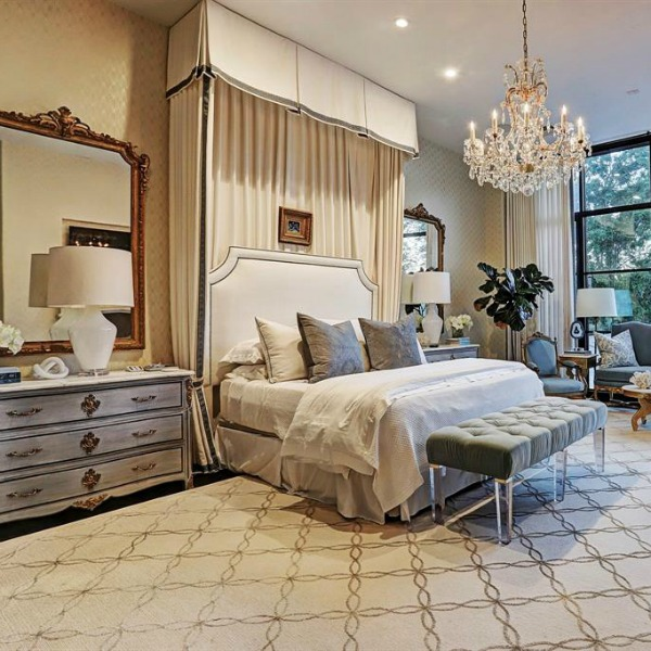 Luxurious, traditional, elegant French country bedroom in a Houston mansion with French country style by TOH. #luxuryhomedesign #bedroomdecor #frenchcountry #customhomedesign