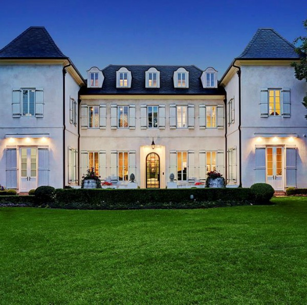 Magnificent French country exterior of a Houston mansion by Thomas O'Neill Homes. #frenchcountry #houseexterior #luxuryhome #homedesign